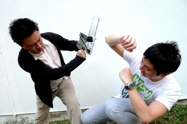 Noel Yeo (left) and Shawn Loo demonstrate an alternative use for the i.Saw